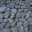 Wall of black stones — Stockfoto