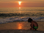 Playing on the beach at sunset — Stock Photo
