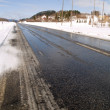 Slippery winter asphalt road — Stock Photo