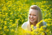 Young teenager girl with yellow flower — Foto de Stock