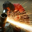 Stock Photo: Welder works sparkle