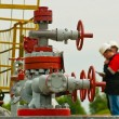 Three industry worker face oil pump — Photo