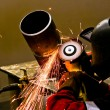 Welding sparks in mask works - Stock Photo