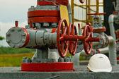 Helmet to oil pump — Stock Photo