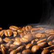 Fragrant coffee grains in a smoke — Stock Photo