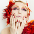 Portrait of a woman with make-up of Phoenix — Stock Photo #5239608