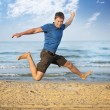 Jumping boy beach — Foto de stock #5049428