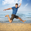 Jumping boy beach — Stock Photo #5049428