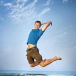 Jumping boy sea — Stock Photo
