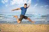 Jumping boy beach — Stock Photo