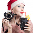 Beautiful girl drinking from lens cup in Christmas hat isolated — Stock Photo