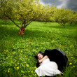 Beautiful girl sleeping in cello case - Stock Photo
