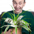 Old man holding money plant — Stok fotoğraf