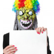 Funny monster with white blank banner — Stockfoto
