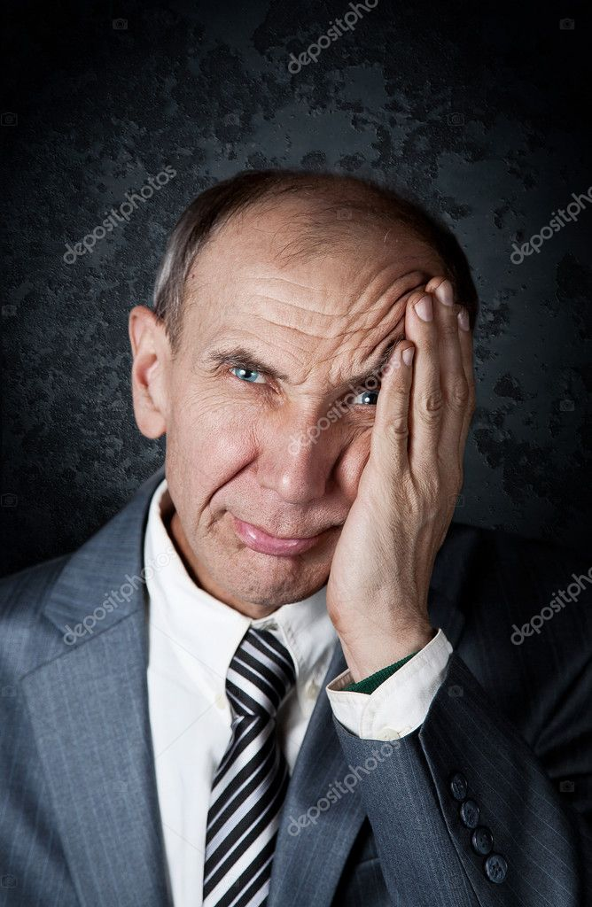 Businessman in frustration at grunge background — Stock Photo #4715424