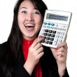 Asian woman with calculator - Stock Photo