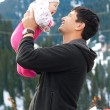 Asian father holding his baby — Stock Photo