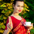 Woman in Indian sari with cup of tea — Stock Photo
