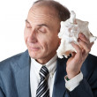 Businessman listening to the shell — Stock Photo