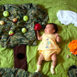 Stock Photo: Baby and red apple in fairy tale