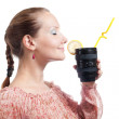 Stock Photo: Womwith telephoto lens cup