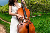 Woman playing the cello — Stok fotoğraf