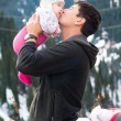 Asian father kissing his baby — Stock Photo