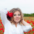Pretty Blonde in poppy field — Stock Photo