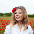 Stock Photo: Pretty Blonde on poppy field background
