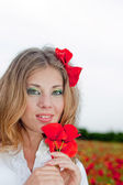 Pretty Blonde with red poppy in hairs3 — Stock Photo