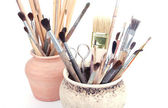 Brushes in pots — Stock Photo