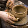 Hands of potter, creating earthen jar on circle — Stock Photo #4787679