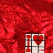 Happy Valentines Day Cube on a red background - Stock Photo