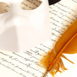 Letter written by Feather - Stock Photo
