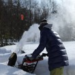 Snow blowing girl — Stock Photo
