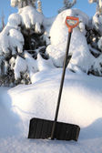 Snow shovel with yellow handle — Stock Photo