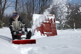 Snow blowing man — Stockfoto