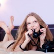 Talking by the phone in a bedroom — Stock Photo