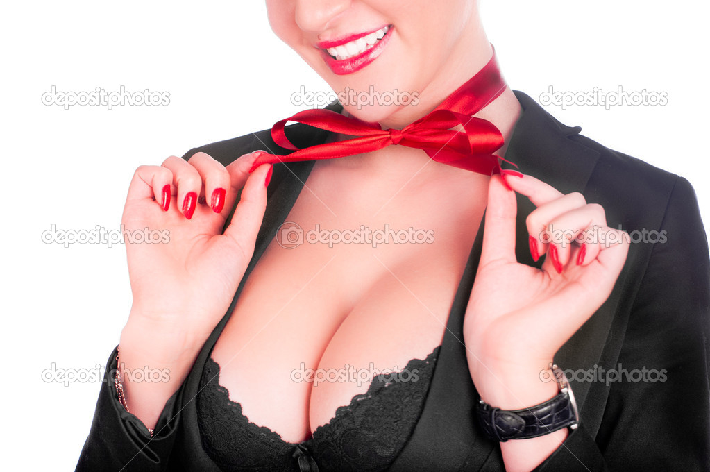A beautiful sexy gril in a black anderwear with a red bow on her neck (isolated on white)  Zdjcie stockowe #4546420