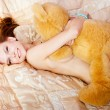 Womwith teddy bear on bed — Stock Photo #4552857