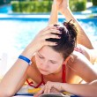 Pretty woman in pool — Stock Photo