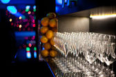 Champagne glasses on the bar — Stock Photo
