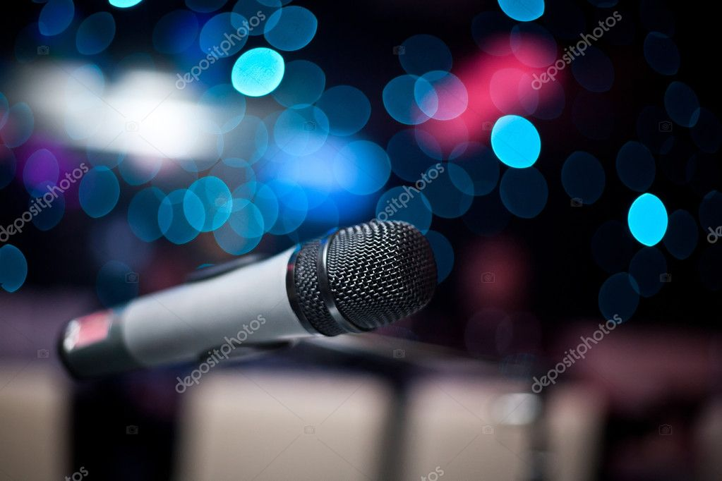 Microphone in nightclub on the background of blurry lights — Stock Photo #4655108