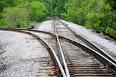 Railroad tracks cross — Stock Photo