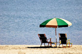 Umbrella and Beach Chairs — Stock Photo