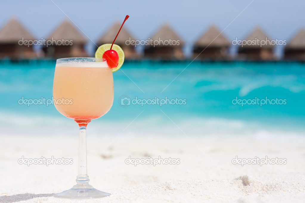 Cocktail on a beach with red cherry — Stock Photo #4548949