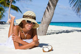 Lady on a tropical beach — Stock Photo