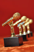 Golden microphones on red background — Stock Photo