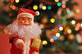 Santa Claus on blur christmas background — Stock Photo