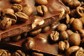 Black chocolate with coffee beans and nuts — Stock Photo